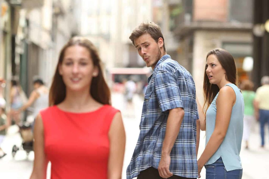 meme of guy checking out a girl while walking with his girlfriend
