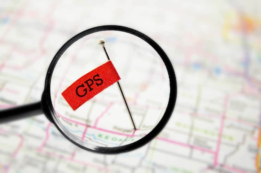 a graphic showing geotagging on a map with a magnifying glass
